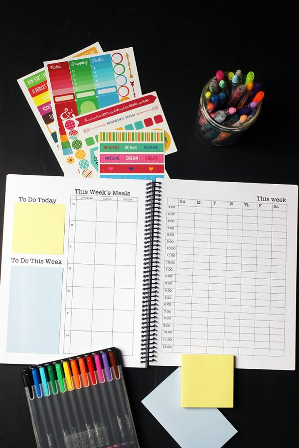 weekly pages of planner with stickers and markers